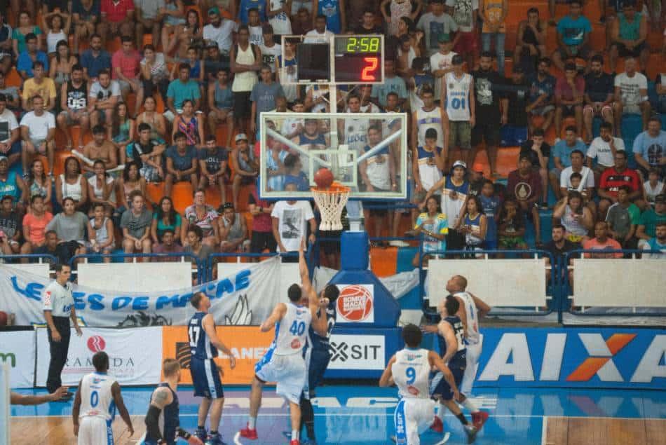 The basketball rattles around the rim.