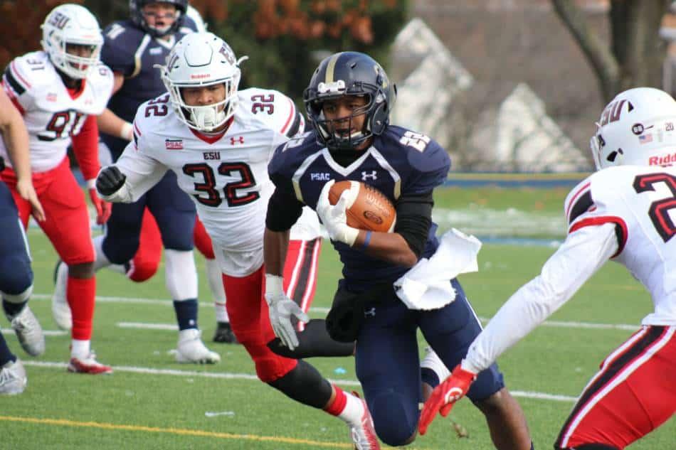 A college football slot receiver runs up field.