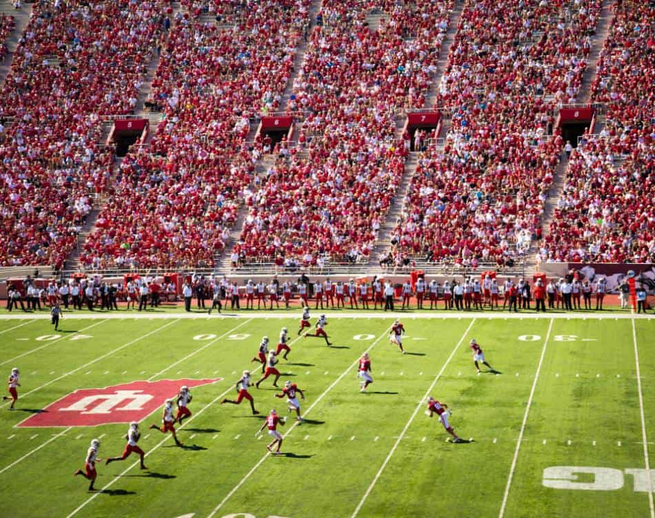 A view of a capacity filled college football stadium.