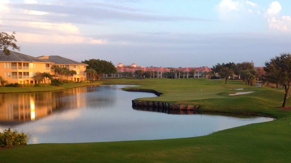 A golf course at sunset.