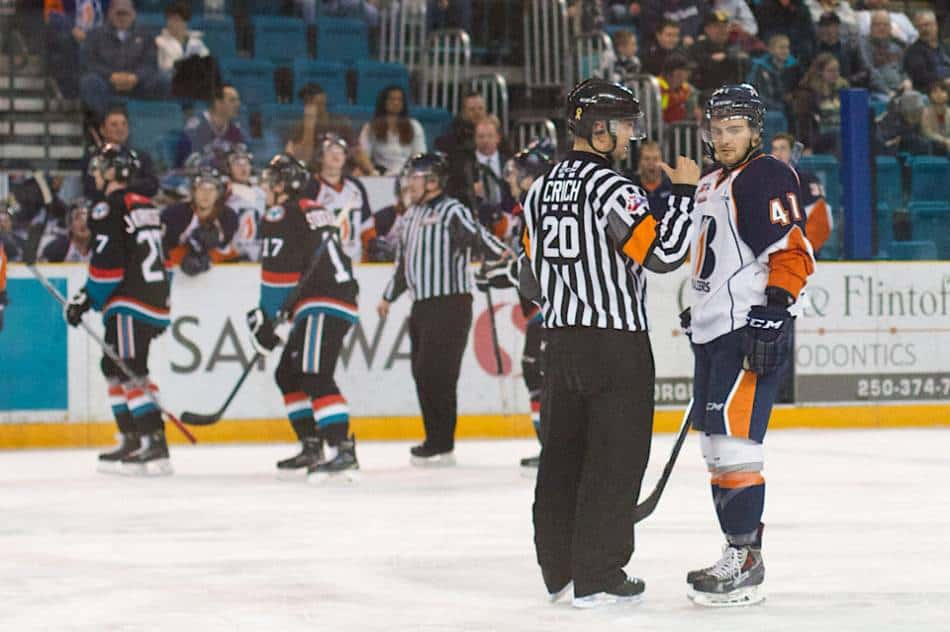 A referee sends a player to the penalty box in overtime.