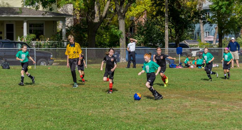 A youth girls soccer game.