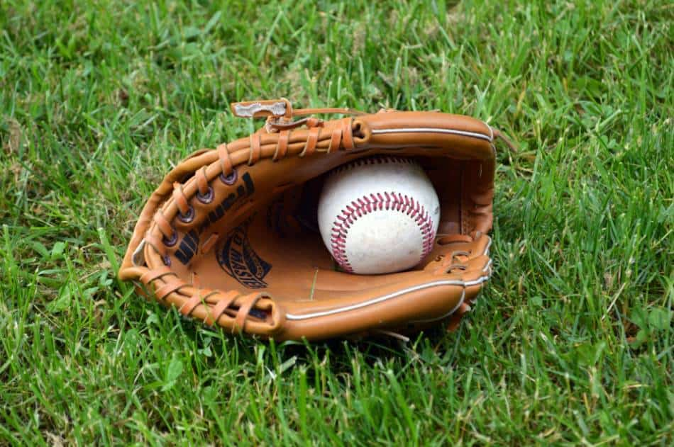 A baseball sitting in a glove.
