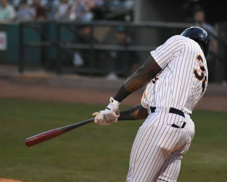 A professional baseball player taking a swing at the plate.