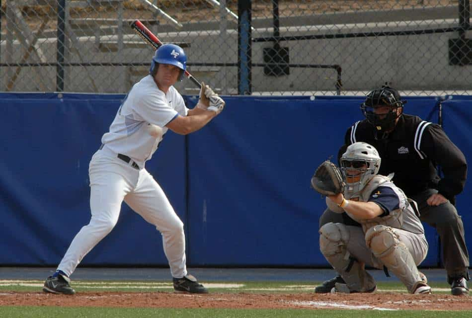 A college baseball player at the plate.