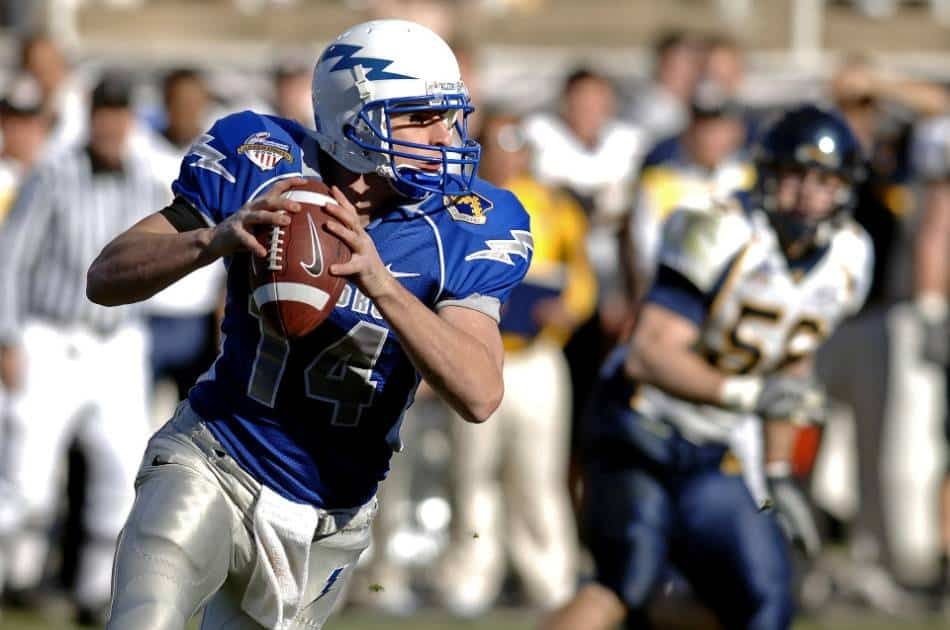 A college quarterback looks to throw the ball.